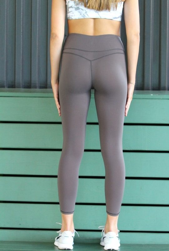 woman wearing gray leggings back