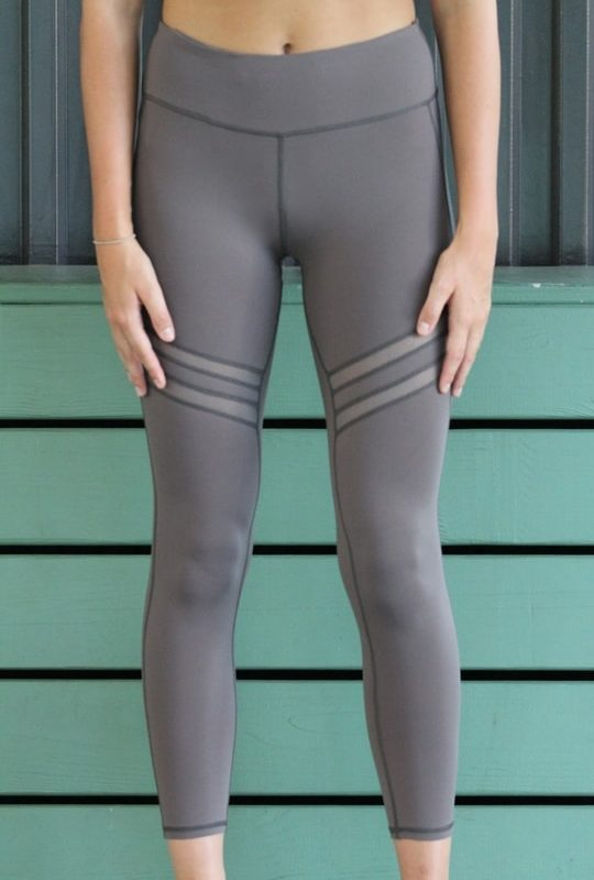 woman wearing gray leggings front
