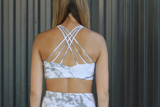 woman wearing marble bra back