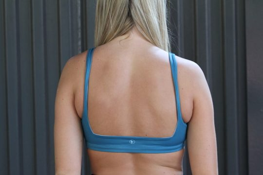 woman wearing turquoise v bra back