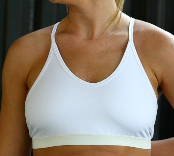 woman wearing white sports bra front
